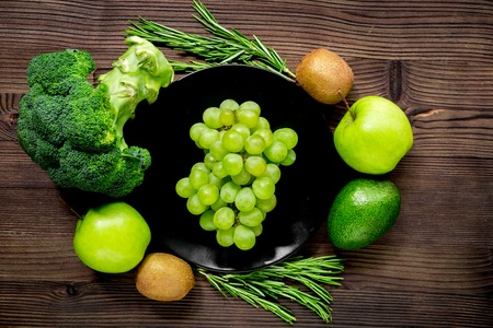 breackfast: healthy green food with fresh vegetables on wooden kitchen table background top view