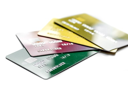 Payment composition with business credit cards at office work place white background close up