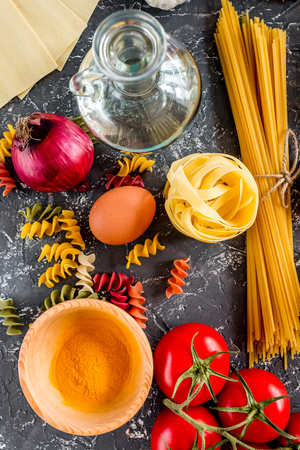 Italian food concept pasta ingredients on grey stone desk background top view close up Stock Photo