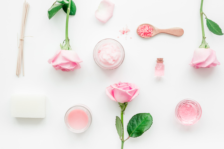 rose organic cosmetics with salt, cream and oil on white table background top view mock up