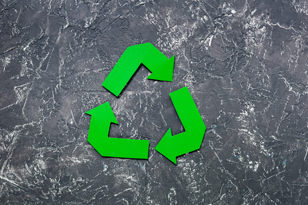 Paper recycle sign on grey stone background top view copyspace Stock Photo