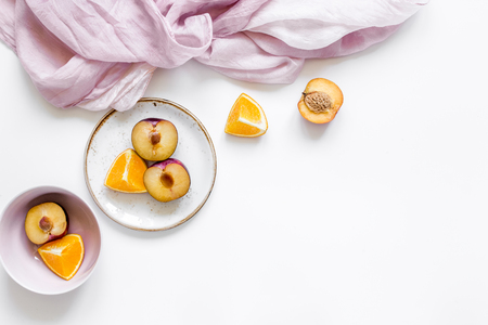 napkin, cut peach and orange for exotic fruit on white background top view mockup