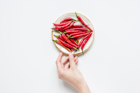 flavouring: hot food with red chili pepper white table background top view mock-up