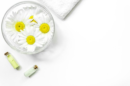 Spa composition with salt, chamomile and towel copyspase top view white background