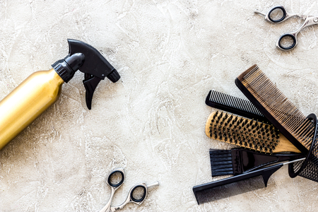 Professional hairdressing tools and accessories on stone table background top view copyspace Stock Photo