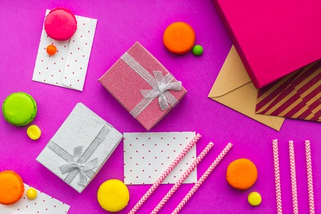 Birthday greeting cards and wrapped gifts on fuchsia background top view Stock Photo