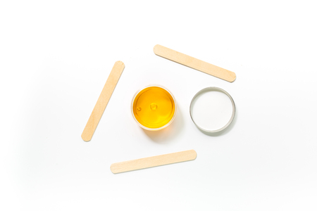 Wax and sticks for depilation on white background top view copyspace Zdjęcie Seryjne