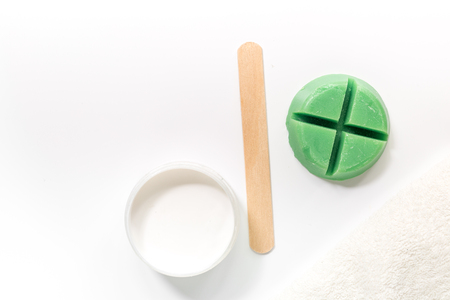 Wax and stick for depilation on white background top view copyspace Stock Photo