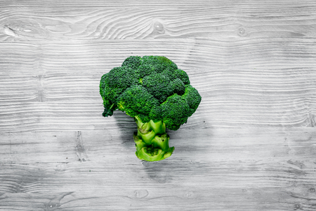 organic food for homemade salad with green broccoli on gray desk background top view