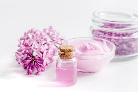 lilac natural cosmetic set for spa with cream white table background Stock fotó