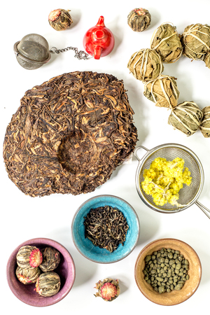 teaparty: Tea-party with different herbal tea on white desk background flat lay pattern Stock Photo