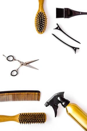 Professional hairdresser equipment on white background top view vertical