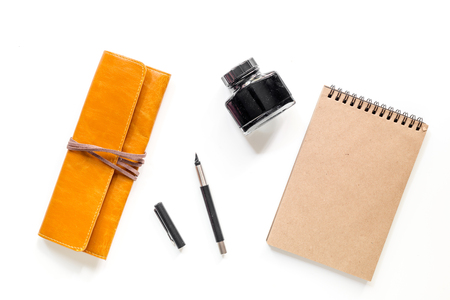 Writer workplace with vintage notebook on white background top view mockup Stock Photo - 80689897