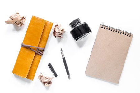 Writer workplace with vintage notebook on white background top view mockup