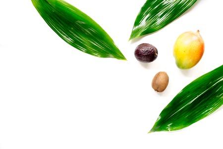 Exotic fruits mangosteen, mango, kiwi and lime on white background top view. Stock Photo