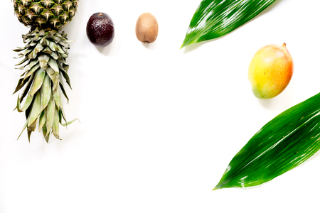 Exotic fruits mangosteen, mango, kiwi and lime on white background top view. Stock Photo