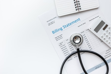 health care costs with billing statement, stethoscope and calculator on white table background top view mockup Stock fotó