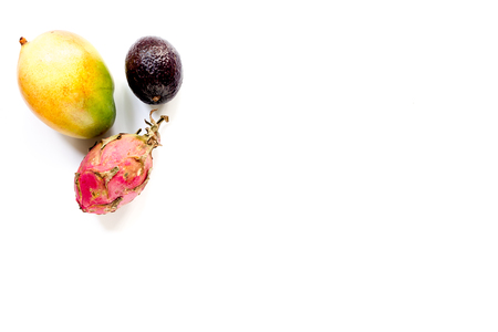 Thai fruits like dragonfruit, mangosteen and mango on white background top view.