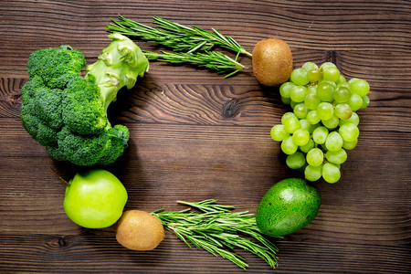 green fresh food for fitness diet on wooden kitchen table background top view mock up
