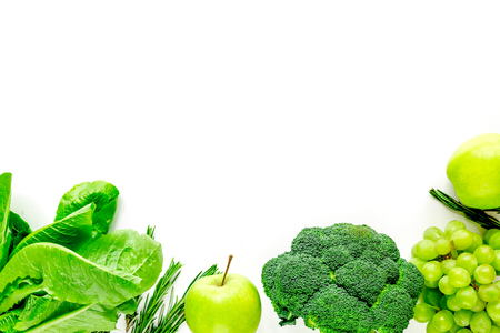 organic food for homemade salad with green vegetables and plate on white kitchen desk background top view mock-up