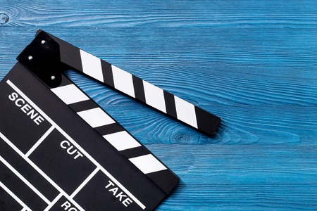 Movie clapperboard on wooden table background top view copyspace Stock Photo