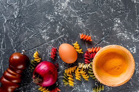 Italian food concept pasta ingredients on grey stone desk background top view copyspace close up