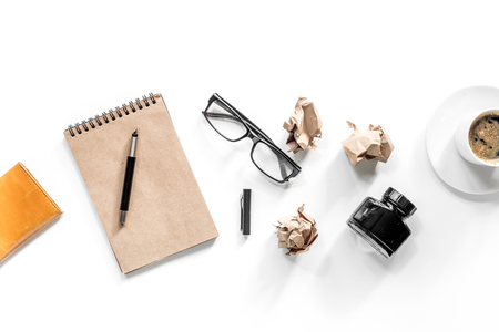 Writer concept. Vintage notebook, crumpled paper and glasses on white background top view Stock Photo - 80787139