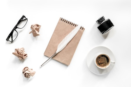 Writer concept. Feather pen, vintage notebook and crumpled paper on white background top view Stock Photo