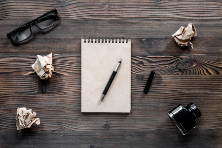 Writer concept. Pen, vintage notebook and crumpled paper on wooden table background top view Stock Photo