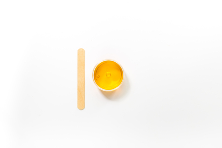 bodycare: Wax and stick for depilation on white background top view copyspace Stock Photo