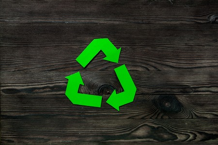 Paper recycling simbol on wooden desk top view copyspace Stock Photo