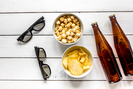 watching TV set with chips, beer and glasses on white background top view Stock Photo - 80765885