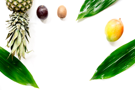 Exotic fruits mangosteen, mango, kiwi and lime with white background top view.