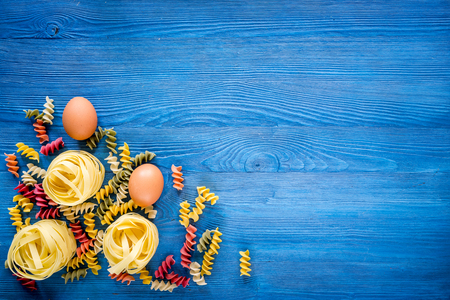 relish: Food ingredients for Italian pasta on blue wooden desk background top view copyspace