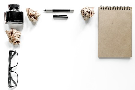 Writer concept. Glasses, pen and notebook on white background top view. Stock Photo - 80892235