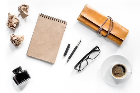 Writer acsessories. Vintage notebook, pen, crumpled paper and coffeee on white background top view mockup Stock Photo - 80892242