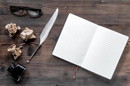 Writer concept. Feather pen, vintage notebook and crumpled paper on wooden table background top view. Stock Photo - 80892247