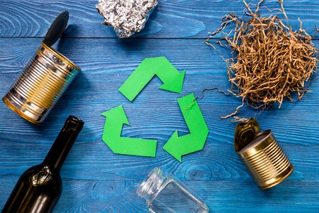 Eco concept with recycling symbol on blue table background top view.