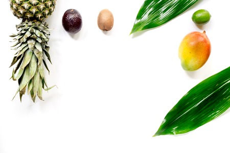 Exotic fruits food concept. Mangosteen, mango, kiwi, pineapple on white background top view copyspace