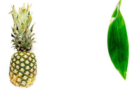 Pineapple and leaves on white background top view copyspace Stock Photo