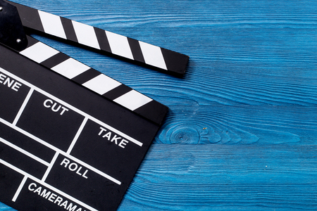 Movie clapperboard on wooden table background top view copyspace Фото со стока