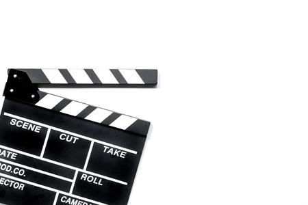Ciak film su sfondo bianco vista dall & # 39 ; alto copyspace Archivio Fotografico - 80929792
