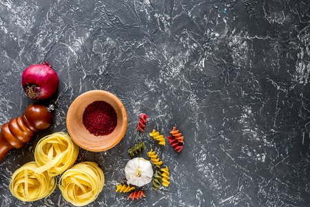 Italian food concept pasta ingredients on grey stone desk background top view copyspace Stock Photo