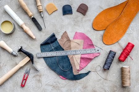 Tools for repairing shoes on grey stone desk background top view Stock Photo