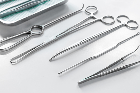 Medical instruments for cosmetic surgery on white table backgrond Stock Photo