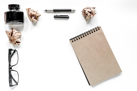 Writer concept. Glasses, pen and vintage notebook on white background top view mockup copyspace Stock Photo