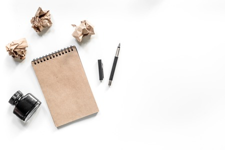 Writer concept. Vintage notebook, pen and crumpled paper on white background top view copyspace mockup