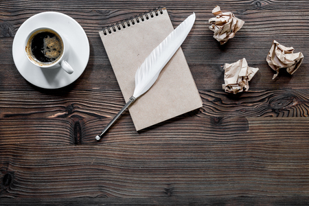 Writer concept. Feather pen, vintage notebook and crumpled paper on wooden table background top view copyspace Stock Photo - 80930933