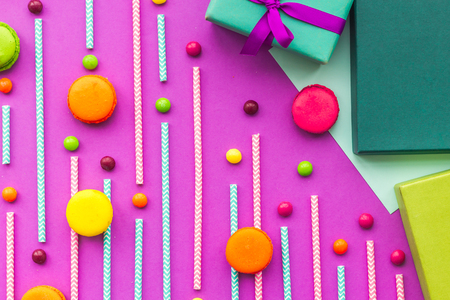 Birthday greeting cards, wrapped gifts and sweets on fuchsia background top view Stock Photo