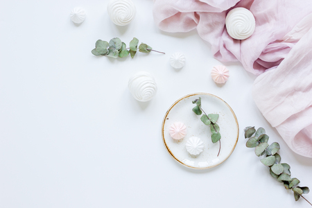 desing: woman desk with plant and marsh-mallow in spring desing on white background flat lay mock up